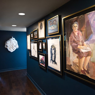 Inspiration for a contemporary dark wood floor and blue floor hallway remodel in Los Angeles with blue walls