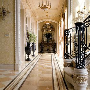Idéer för att renovera en mycket stor medelhavsstil hall, med beige väggar, marmorgolv och flerfärgat golv