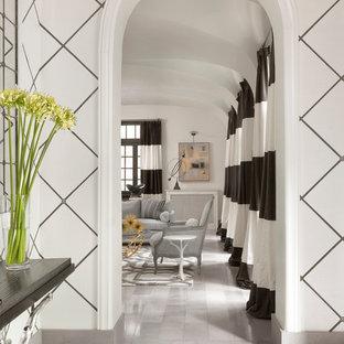На фото: большой коридор в стиле современная классика с синими стенами, полом из терраццо и серым полом