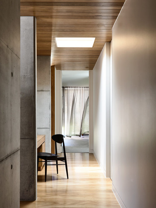 Photo Of A Mid Sized Modern Hallway In Melbourne With Grey Walls, Light  Hardwood