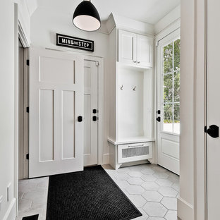 Hallway - small craftsman ceramic floor hallway idea in Other with white walls