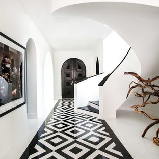 Large trendy marble floor and white floor hallway photo in Dallas with white walls