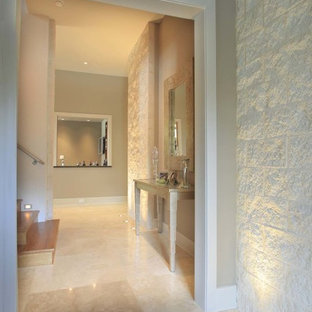 Inspiration for a large modern travertine floor hallway remodel in Houston with white walls