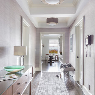 Inspiration for a transitional medium tone wood floor hallway remodel in New York with purple walls