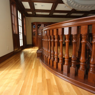 Example of a mid-sized trendy light wood floor hallway design in Other with beige walls