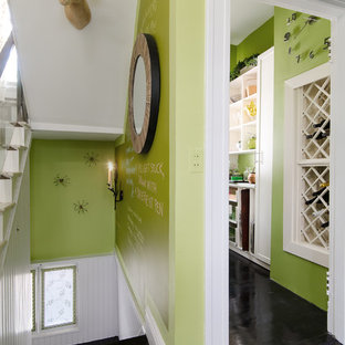 Inspiration for an eclectic painted wood floor and black floor hallway remodel in Richmond with green walls