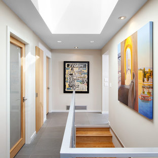 Inspiration for a midcentury hallway in Vancouver with porcelain floors.