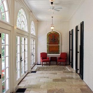 Large elegant ceramic floor hallway photo in Cincinnati with white walls