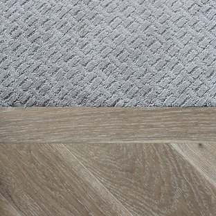 Inspiration for a mid-sized timeless carpeted and gray floor hallway remodel in Edmonton