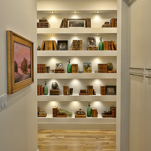 Design ideas for a contemporary hallway in Austin with white walls and medium hardwood floors.