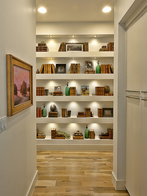 Inspiration For A Contemporary Medium Tone Wood Floor Hallway Remodel In Austin With White Walls
