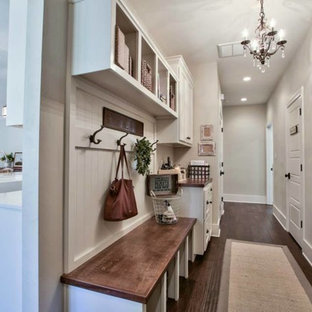 This is an example of a large beach style hallway in Atlanta with white walls and dark hardwood floors.