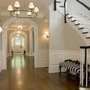 Expansive beach style hallway in Chicago with beige walls and medium hardwood floors.