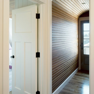 Mid-sized beach style hallway in Providence with dark hardwood floors and brown walls.