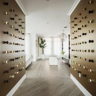 Example of a trendy medium tone wood floor hallway design in Phoenix with brown walls
