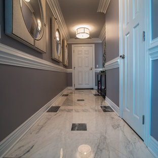 Hallway - mid-sized contemporary marble floor hallway idea in Chicago with gray walls
