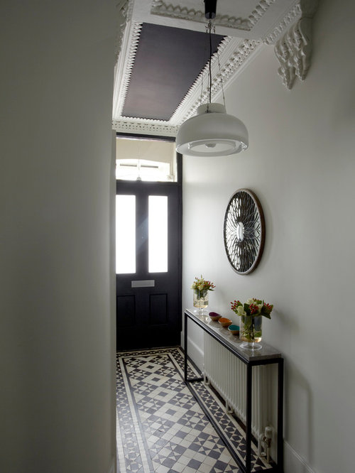 Inspiration for a victorian multicolored floor hallway remodel in London