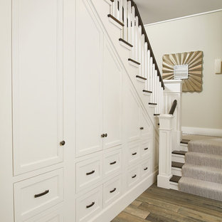 Design ideas for a beach style hallway in Grand Rapids with medium hardwood floors and brown floor.