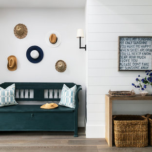 Design ideas for a large beach style hallway in Sussex with white walls.