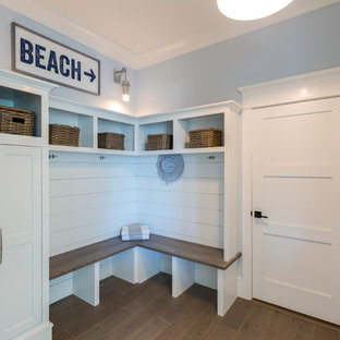 Design ideas for a large beach style hallway in Other with blue walls, medium hardwood floors and grey floor.