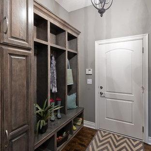 Mid-sized elegant dark wood floor and brown floor hallway photo in Kansas City with gray walls