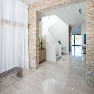 Hallway - contemporary marble floor and beige floor hallway idea in Miami with white walls