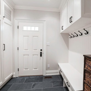Mid-sized elegant slate floor hallway photo in Toronto with white walls