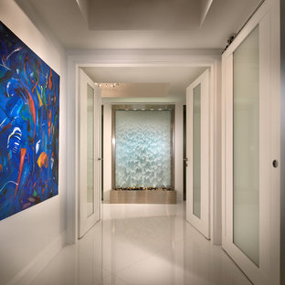 Trendy white floor hallway photo in Miami with white walls