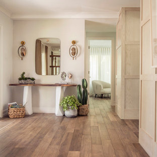 Mid-sized danish porcelain floor and brown floor hallway photo in Miami with white walls