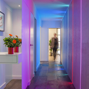 Example of a trendy medium tone wood floor hallway design in London
