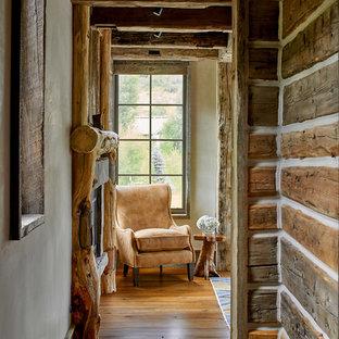 Hallway - rustic medium tone wood floor and brown floor hallway idea in Denver with white walls