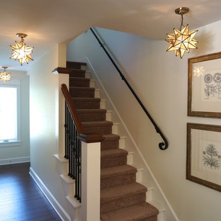Design ideas for a small arts and crafts hallway in Cleveland with white walls.