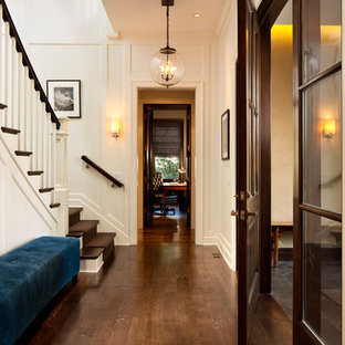 Photo of a mid-sized traditional hallway in Chicago with white walls and dark hardwood floors.