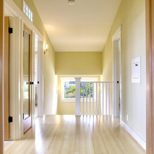 Inspiration for a timeless light wood floor and beige floor hallway remodel in Seattle with beige walls