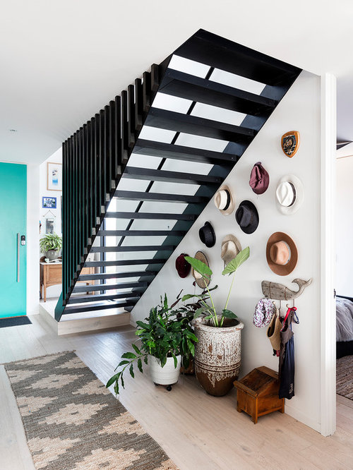 Mid Sized Modern Hallway In Sydney With White Walls And Light Hardwood  Floors.
