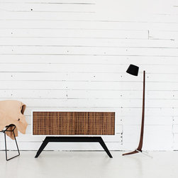 Custom Elko Credenza - This is our Elko Credenza with doors from Plyboo's new Linear line. This piece is a fresh take on vintage cloth doors that were used in mid-century stereo cabinets. The body of the piece is painted white with black laser cut steel base. Oh, and don't forget the smooth sliding hardware on the doors!