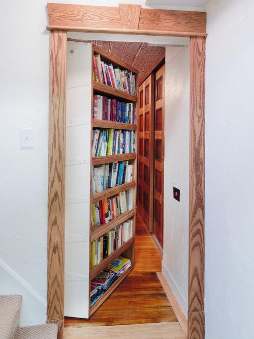 Inspiration for a timeless medium tone wood floor hallway remodel in Boston with white walls & Hidden Door | Houzz