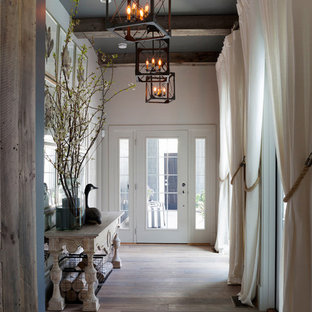 Large beach style light wood floor and gray floor hallway photo in Wilmington with white walls