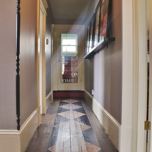 Inspiration for a small eclectic painted wood floor hallway remodel in Seattle with purple walls