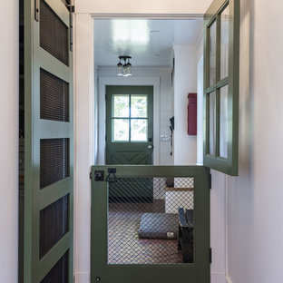 Example of a mountain style brick floor hallway design in Louisville with white walls