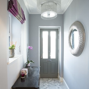 Inspiration for a contemporary terra-cotta floor and gray floor hallway remodel in Surrey with white walls