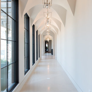 Inspiration for a transitional beige floor hallway remodel in Phoenix with white walls
