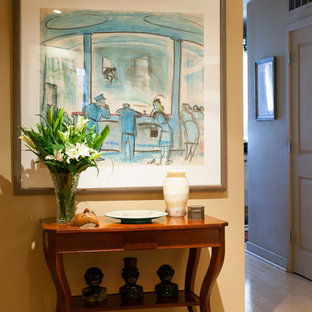 Example of a mid-sized trendy light wood floor hallway design in Boston with beige walls