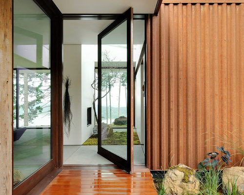 Ex&le of a mid-sized trendy hallway design in Seattle with white walls and concrete & Pivot Door | Houzz Pezcame.Com