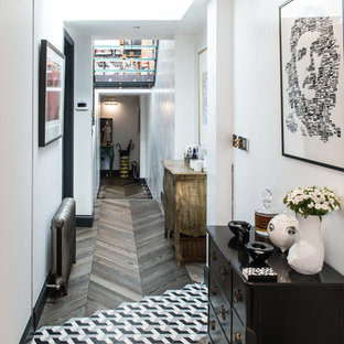 Hallway - small contemporary multicolored floor and dark wood floor hallway idea in London with white walls