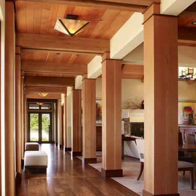 Example of a large trendy medium tone wood floor and brown floor hallway design in San Francisco with beige walls