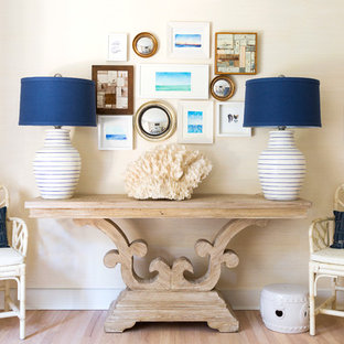 Inspiration for a large beach style hallway in New York with beige walls and light hardwood floors.