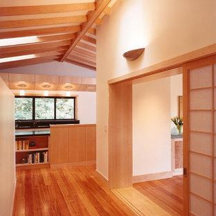 Asian medium tone wood floor hallway photo in San Francisco with white walls