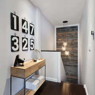 Inspiration for a mid-sized contemporary dark wood floor and brown floor hallway remodel in New York with white walls