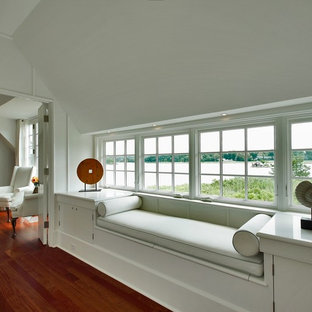 Inspiration for a mid-sized beach style hallway in New York with white walls, medium hardwood floors and red floor.